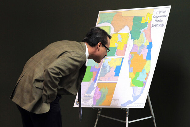 Florida Republican state Sen. Rene Garcia examines a map of proposed changes in congressional districts in January 2012.
