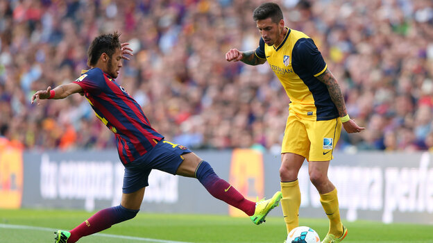 Allegations surrounding the signing of Neymar da Silva Santos Júnior of FC Barcelona (shown here, left, tackling Jose Sosa of Club Atletico de Madrid on May 17 in Barcelona) are at the heart of tax fra