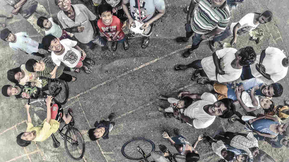 The drone operator who took this photo normally takes images from far above this height. But a trip to a park in Manila drew a crowd.