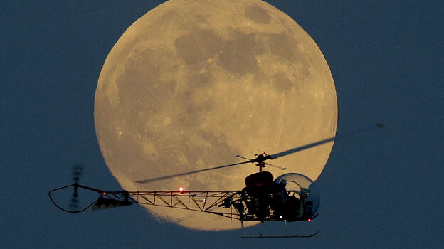The moon appeared bigger and brighter when it went supermoon on June 23, 2013 — especially when it was seen next to objects on the horizon, such as the helicopter from the original Batman television show at the New J