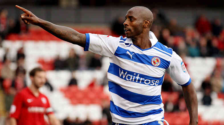Retired U.K. soccer player Jason Roberts, seen here in 2012 playing for Reading, says he's experienced racism in the sport since his teens.
