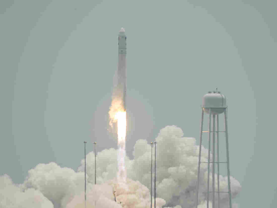 In a photo provided by NASA, the Orbital Sciences Corporation Antares rocket launches with the Cygnus spacecraft aboard, on Sunday from NASA's Wallops Flight Facility in Virginia.