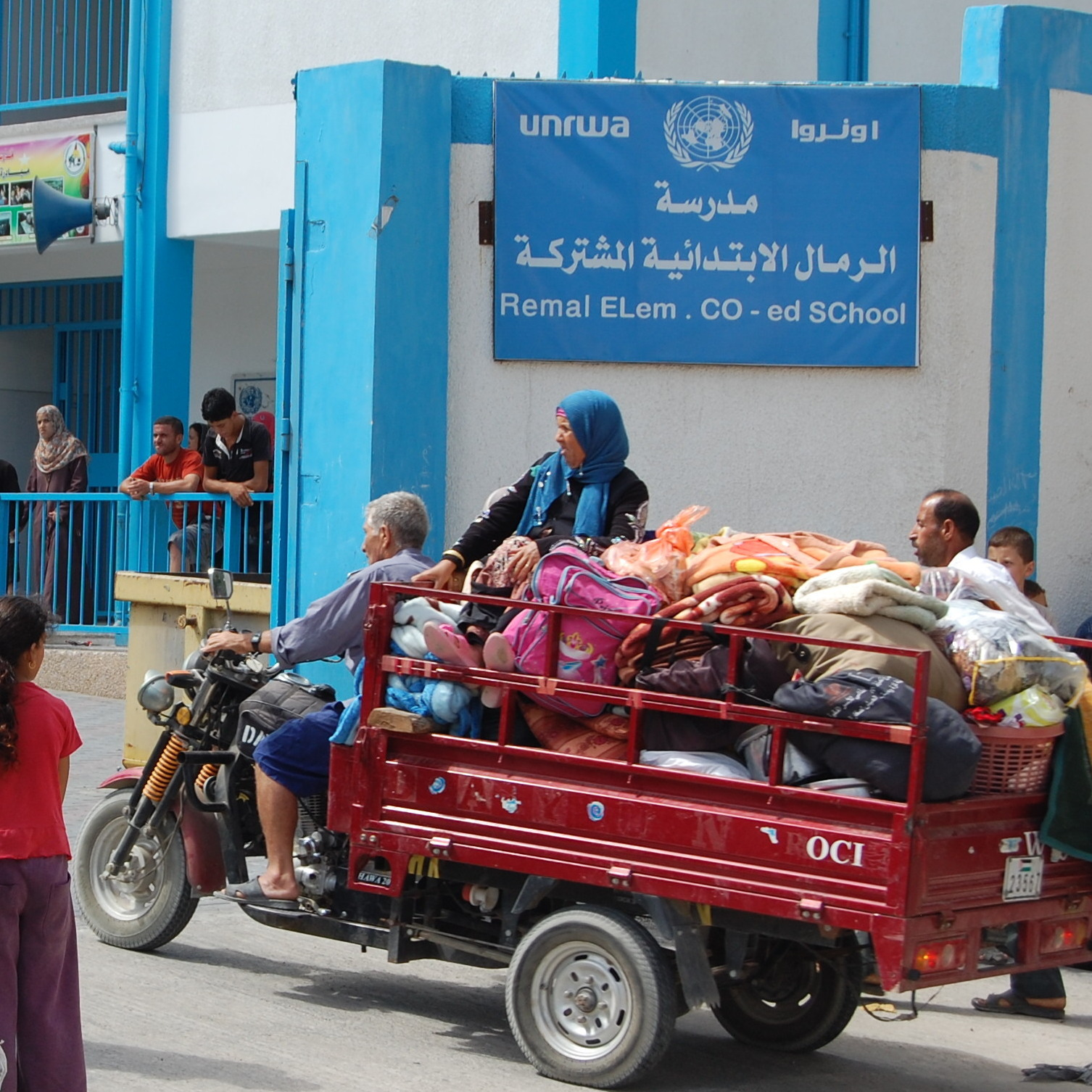 Palestinian families arrive at al-Remal Elementary School, which is run by the U.N. Relief and Works Agency, or UNRWA. The director of UNRWA operations in Gaza says the U.N. expects 50,000 evacuees to seek shelter at schools like this one.