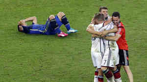 Germany's players celebrate after winning 1-0 on extra time at the World Cup final soccer match between Germany and Argentina at the Maracana Stadium in Rio de Janeiro, Brazil on Sunday.