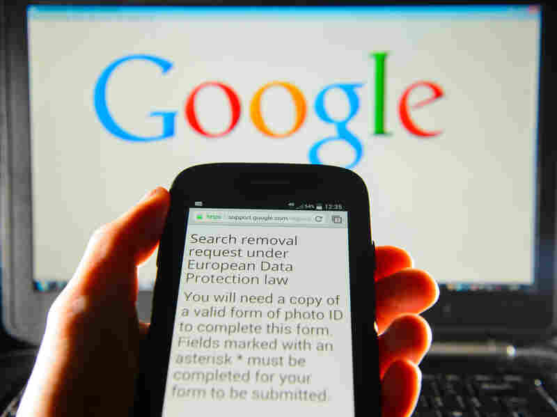 A Google search removal request is displayed on the screen of a smartphone in London. The company says it has received more than 70,000 takedown requests following a European court ruling.