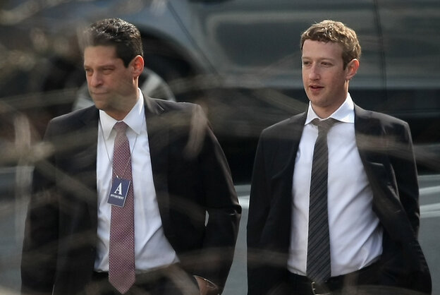 Facebook CEO Mark Zuckerberg (right) and Facebook lobbyist Joel Kaplan are part of the Internet Association, which filed comments in support of net neutrality Monday.