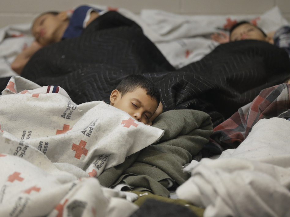 Child detainees in a holding cell at a Border Patrol facility in Brownsville, Texas. Some human smugglers who bring children across the Rio Grande make sure to treat their clients well. (Eric Gay/AP)