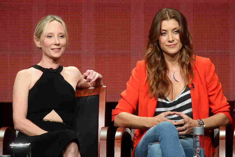 Executive producer Anne Heche (left) and actress Kate Walsh speak at the Bad Judge panel during the 2014 Summer Television Critics Association in Beverly Hills, Calif.