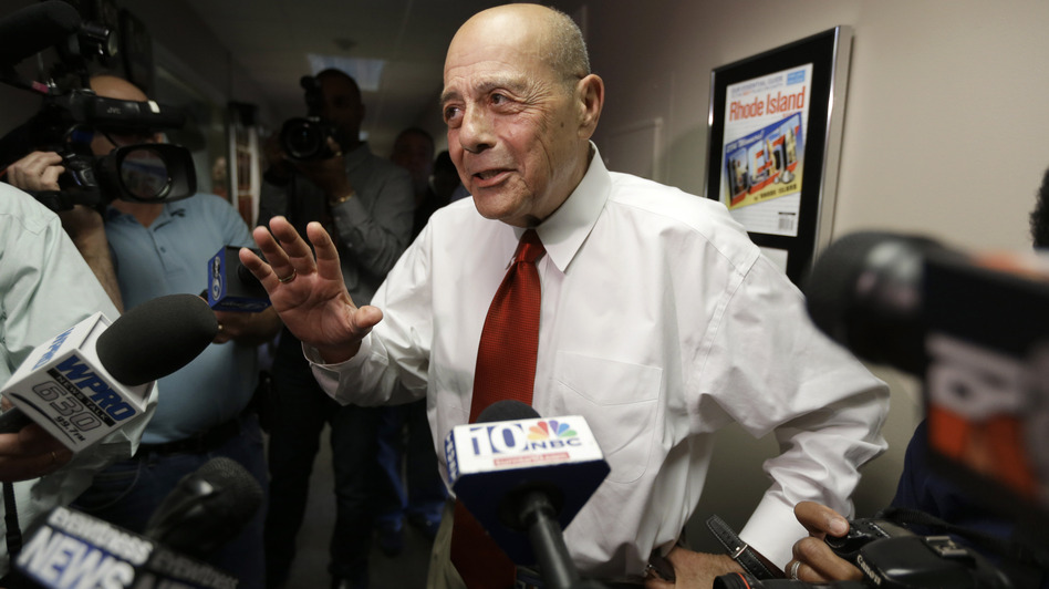 Former Providence Mayor Buddy Cianci speaks with reporters moments after announcing he will again run for mayor. Cianci, who made the announcement June 24 on WPRO-AM, was mayor for 21 years - longer than anyone else. (Steven Senne/AP)