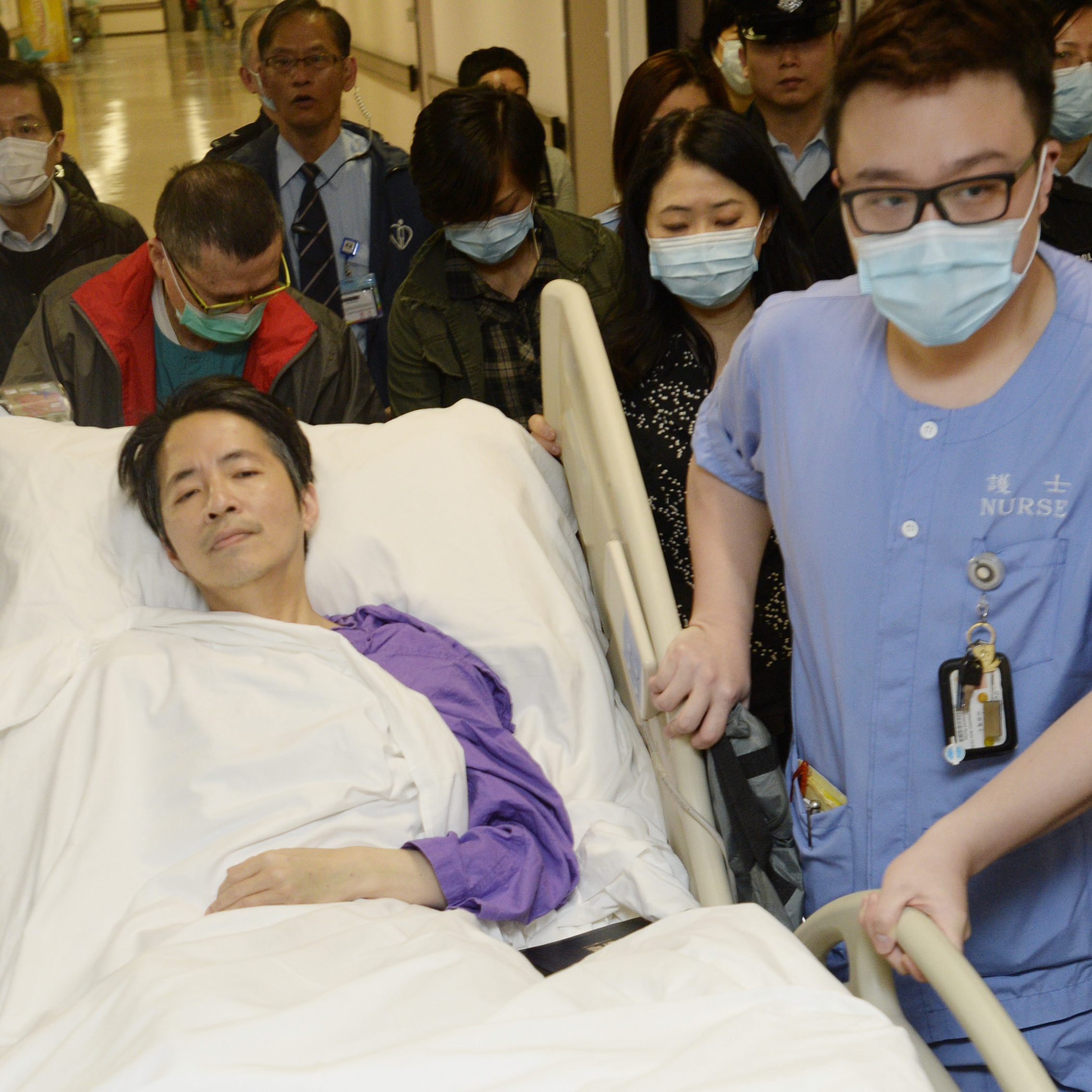 Former Ming Pao chief editor Kevin Lau is transferred to a private ward in a hospital Saturday in Hong Kong after three days in intensive care.