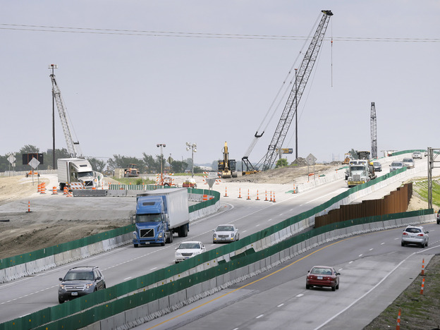 Traffic passes a construction zone at the interchange of U.S. Highway 65 and Interstate 80 on May 30 in Altoona, Iowa.