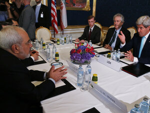 Iran's Foreign Minister Mohammad Javad Zarif (left) meets with U.S. Secretary of State John Kerry (right) in Vienna on Sunday.