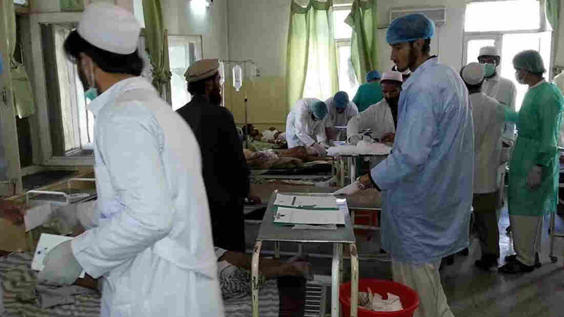 Afghan doctors assist civilians wounded by a suicide bomber in Paktika province on Tuesday.