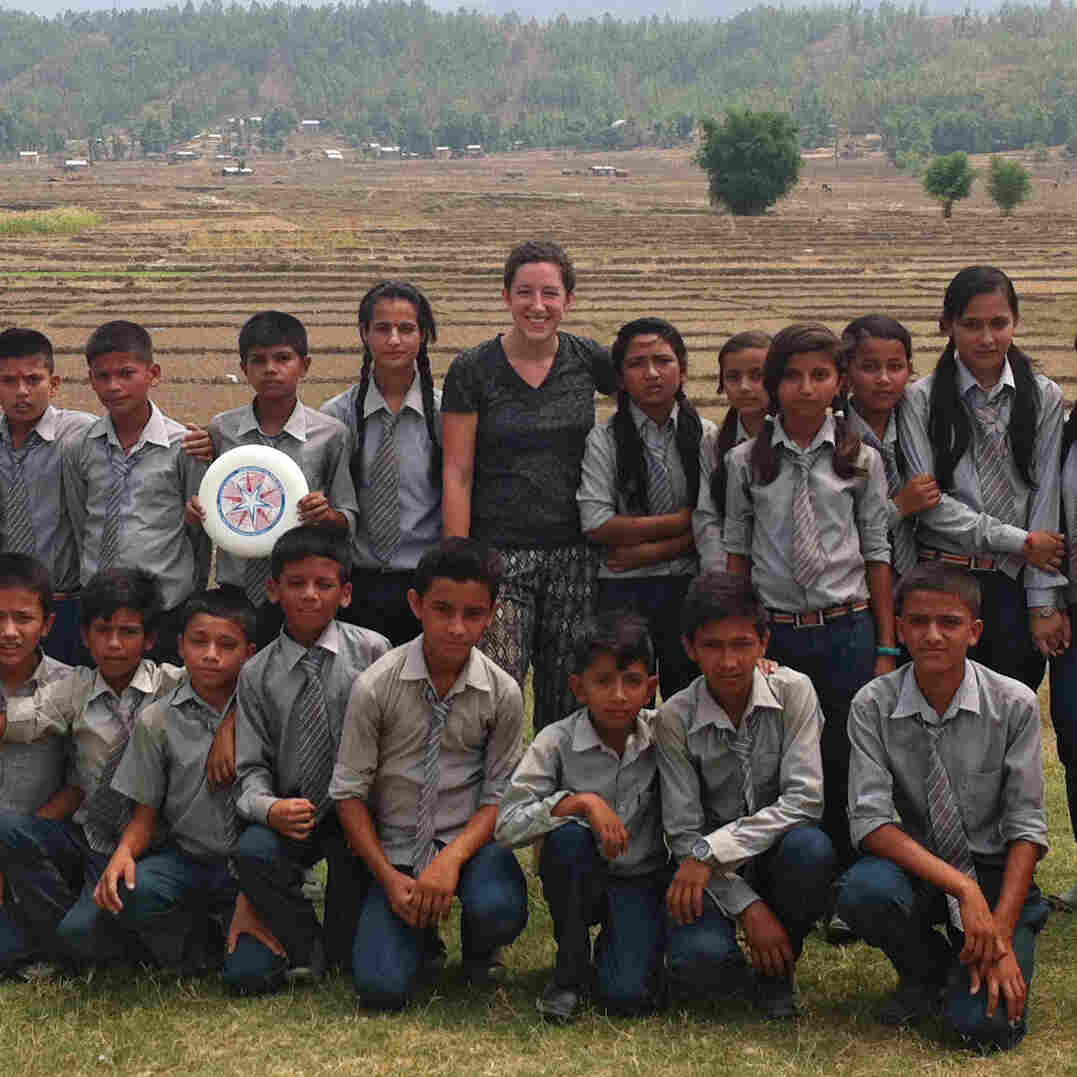 """Hannah Marqusee taught these Nepali 8th- and 9th-graders to play Ultimate Frisbee. """"Despite being terrible at throwing, they had a really good time,"""" she reports. Their verdict: slightly more fun than soccer but not quite as fun as cricket. Bottom row, fourth from the right, is her host brother, Sachin."""