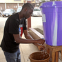 Ebola precautions are taking hold in Sierra Leone. A man washes with disinfectant before entering a hospital in the capital city of Freetown.