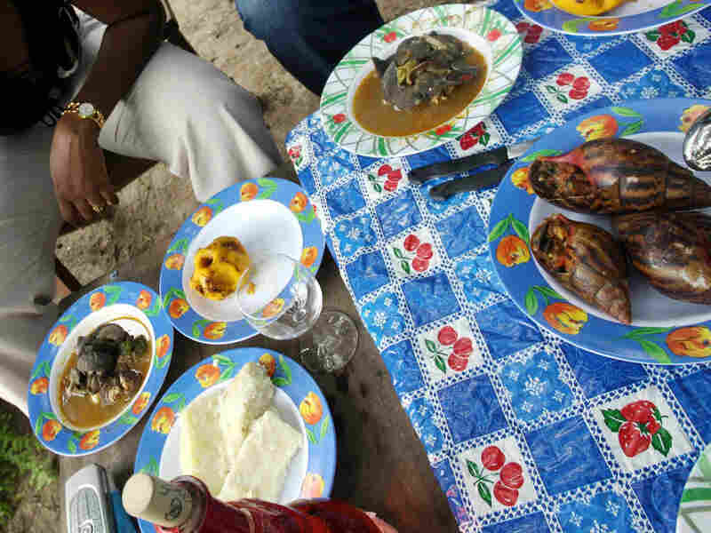 A woman eats snails in Ahoue, a village in Ivory Coast, during a snail festival in 2006.