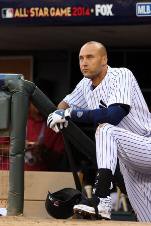 American League All-Star Derek Jeter #2 of the New York Yankees looks on from the dugout during the 85th MLB All-Star Game at Target Field Tuesday night in Minneapolis, Minn.