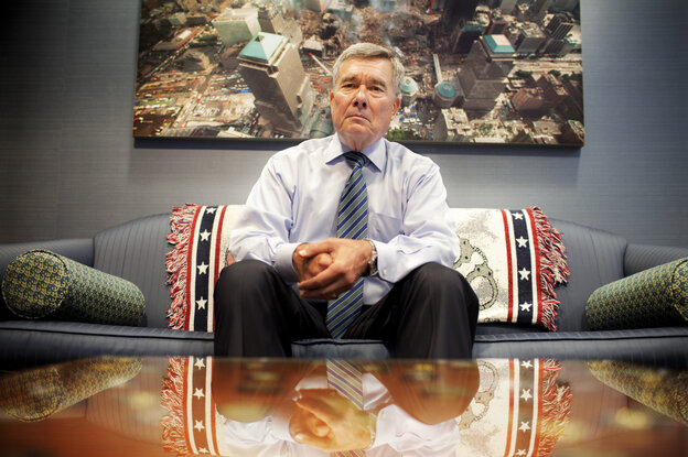 U.S. Customs and Border Protection Commissioner R. Gil Kerlikowske sits under an image of New York's Ground Zero in