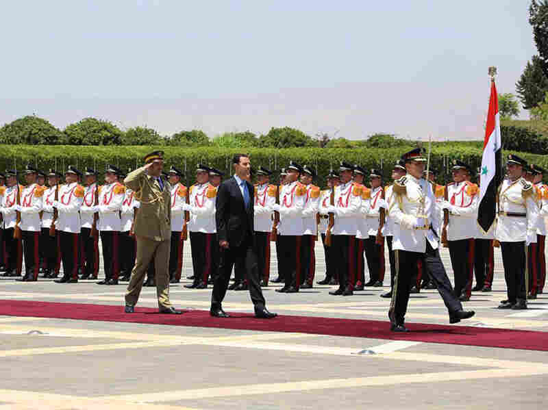 Syrian President Bashar Assad reviews the honor guard upon his arrival at the presidential palace in Damascus to take the oath of office for his third seven-year term.