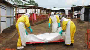 Musa James died of Ebola on Monday. Staff from Doctors Without Borders prepare the body of the 70-year-old for burial.