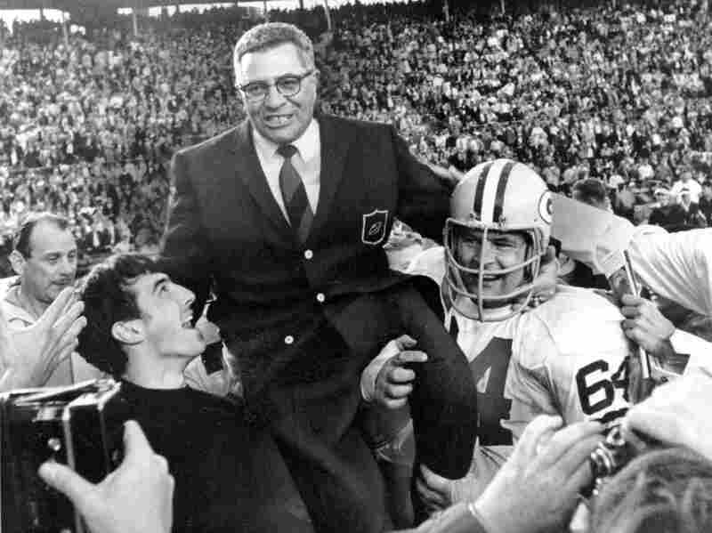 Green Bay Packers coach Vince Lombardi basks in the glory of his team's big win in Super Bowl II, 1968.