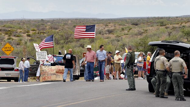 In Oracle, Ariz., on Tuesday, protesters gather near the entrance to a juvenile fac