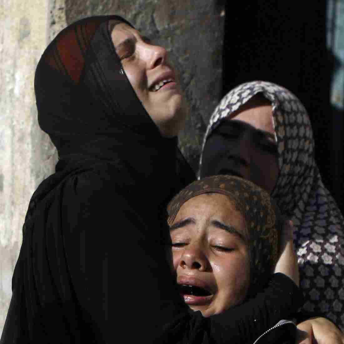Palestinians weep at the funeral Wednesday for four boys, ages 9 to 12 and all cousins from the extended Bakr family. They were killed in an Israeli attack in Gaza City.