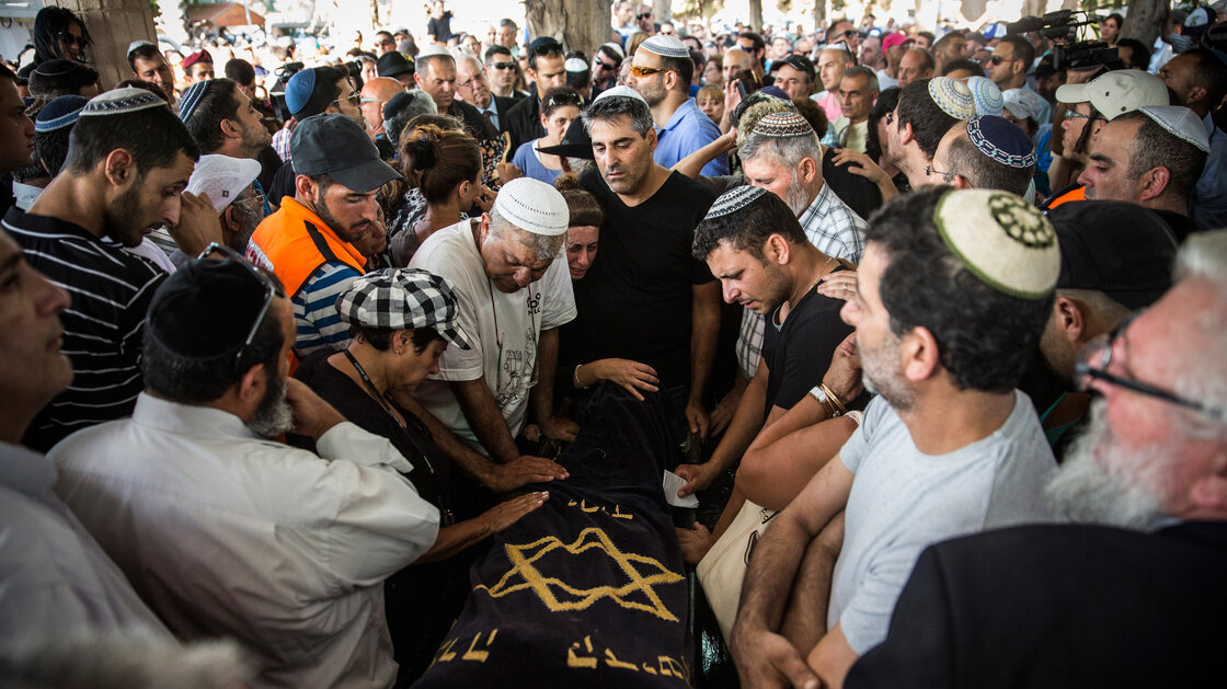 Mourners weep during the funeral of Dror Hanin at a cemetery on Wednesday in Yahud Monoson, Israel. Hanin, who was hit by a Palestinian mortar, was the first Israeli to be killed in the current round of fighting. More than 200 Palestinians have been killed.