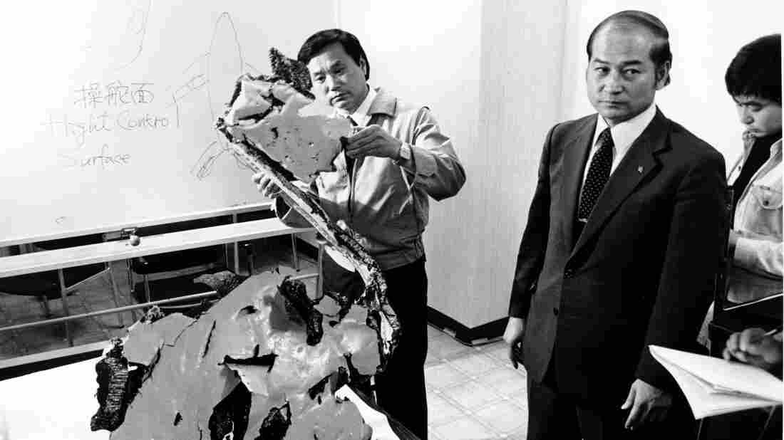 A Korean Airlines official, Suk Jin-ku, examines a piece of aircraft debris in Japan on Sept. 12, 1983. Eleven days earlier, a Soviet warplane shot down a Korean Air Lines plane that had strayed into Soviet airspace. All 269 people onboard were killed, including U.S. Rep. Lawrence McDonald.