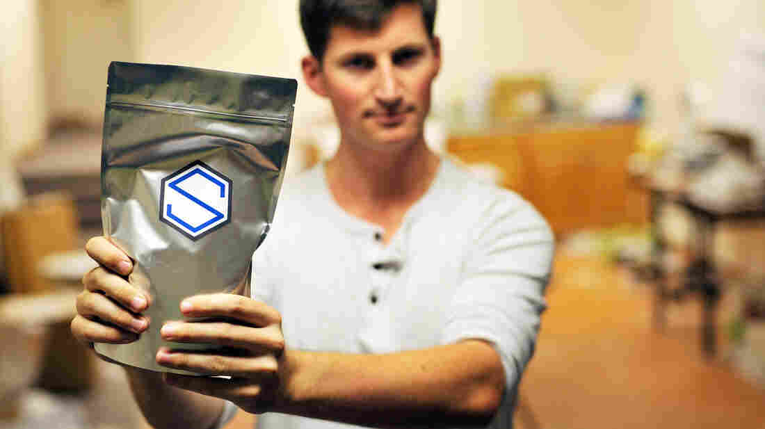 Soylent CEO Rob Rhinehart holds a bag of finished product in September 2013. Rhinehart recently discouraged members of the company's DIY online community from competing directly with Soylent.