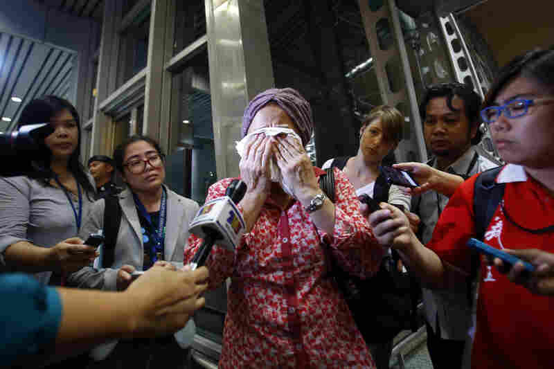 A woman at Kuala Lumpur International Airport reacts to news of the crash.