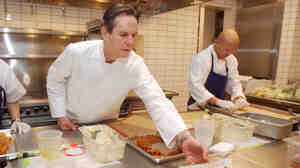 Chef Thomas Keller checks out preparations in the kitchen of his New York restaurant, Per Se, in the Time Warner Center, in February 2004.