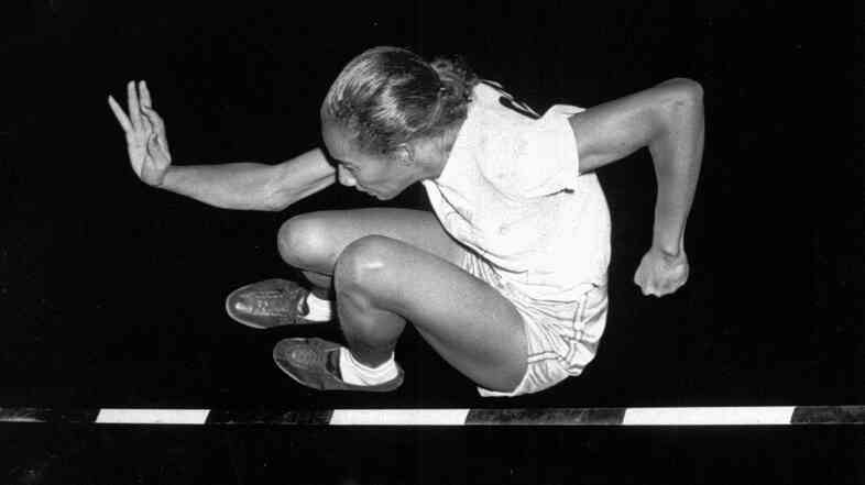 Alice Coachman clears the bar at 5 feet to win the running high jump at the Women's National Track Meet in Grand Rapids, Mich., in 1948.