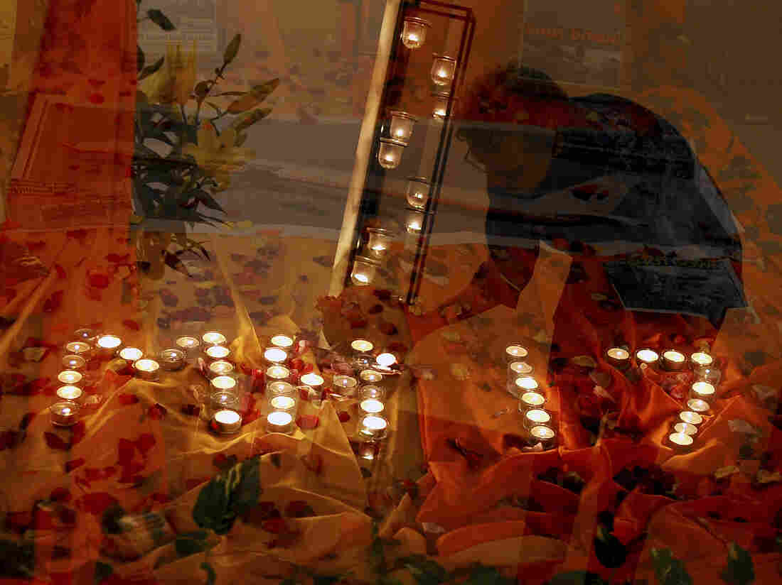Candles commemorating the dead spell out MH17, the flight number of the plane that crashed Thursday, at a church in Kuala Lumpur on Friday.
