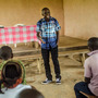 Saidu Kanneh speaks to the community in Koindu, Sierra Leone, about surviving Ebola. He spent 12 days in a treatment center and was released this week.