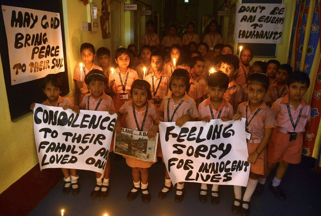 Indian school children hold candles and prayer messages for those killed in the crash of a Malaysia Airlines plane carrying 298 people from Amsterdam to Kuala Lumpur.