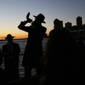 Rabbi Aaron Raskin plays the shofar as Jews mark Rosh Hashanah during a traditional Tashlich ceremony in September 2013 in the Brooklyn borough of New York City. A new Pew poll asked how warmly Americans felt toward people of varying religious groups.