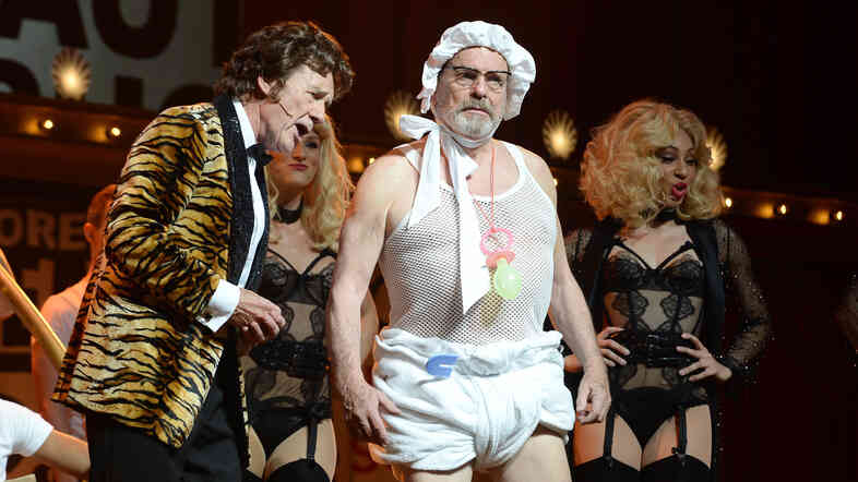 Michael Palin, left, and Terry Gilliam perform on the opening night of Monty Python Live (Mostly). The final performance of the reunion show, on Sunday, will be live-streamed at theaters around the world.