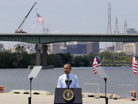 President Obama speaks in front of the Interstate 495 bridge near Wilmington, Del., on Thursday. Obama said he supports the temporary highway bill passed by the House last week — but he doesn't like it.