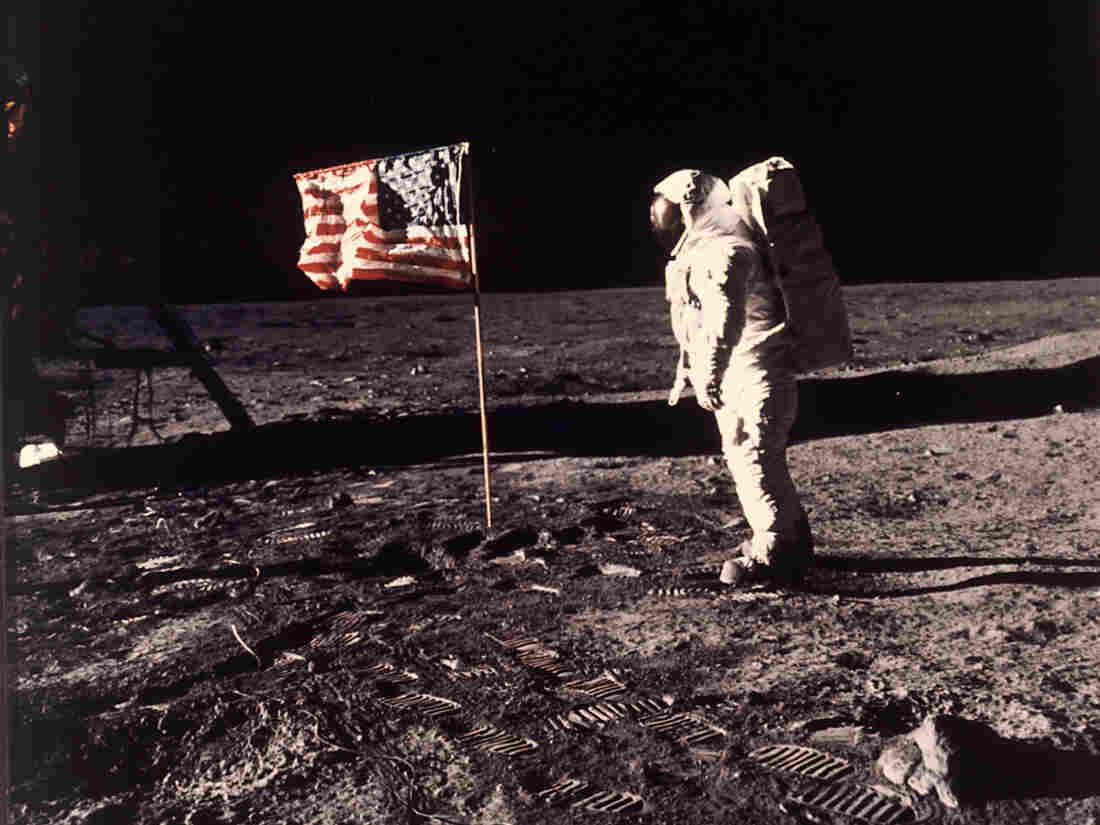 "Astronaut Edwin E. ""Buzz"" Aldrin Jr. posing for a photograph beside the U.S. flag deployed on the moon during the Apollo 11 mission, 45 years ago."