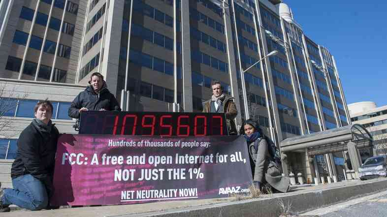 Members of global advocacy group Avaaz stand next to a digital counter showing the number of petition signatures calling for net neutrality outside the Federal Communication Commission in Washington in January. Avaaz joined other groups to deliver more than a million signatures for a free and open Internet to the FCC.