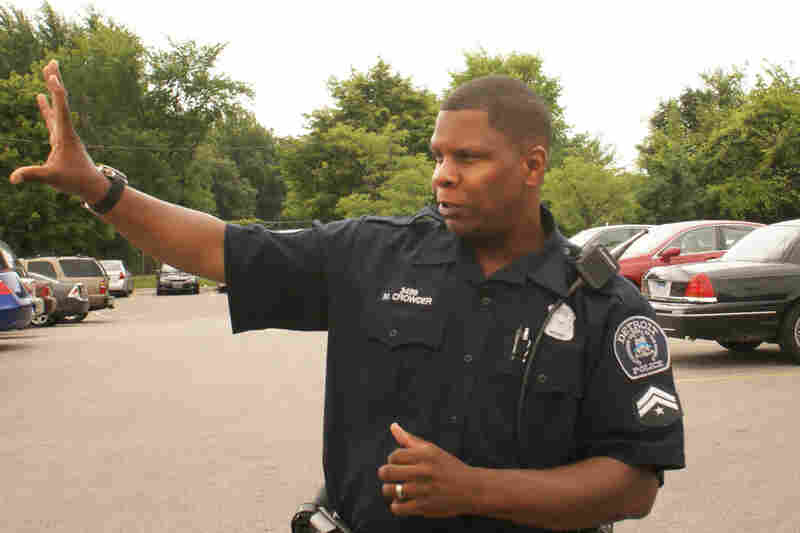 Officer Michael Crowder says his roots are too deep to leave Detroit, but he knows younger officers who were lured away by better pay.