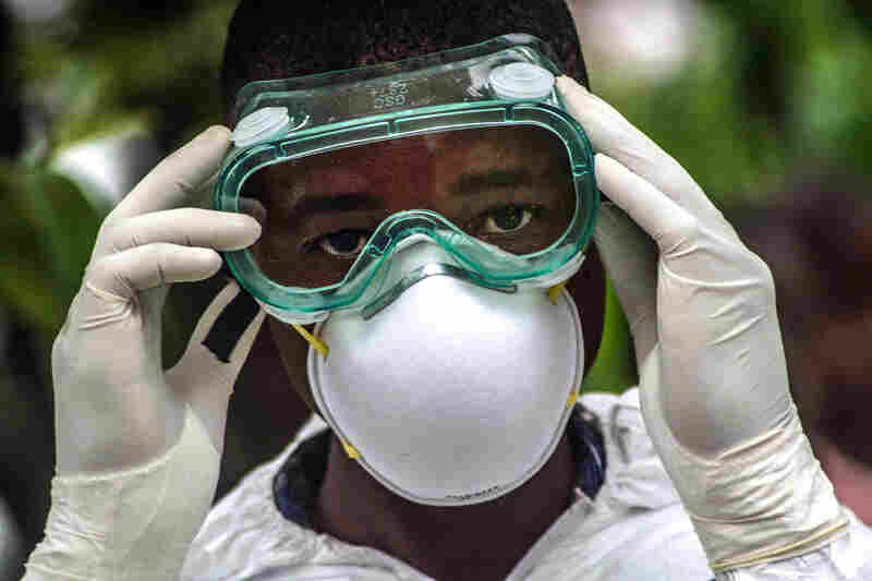 Sylvester Jusu, a Red Cross volunteer, wears a suit and goggles to protect himself from contracting Ebola.