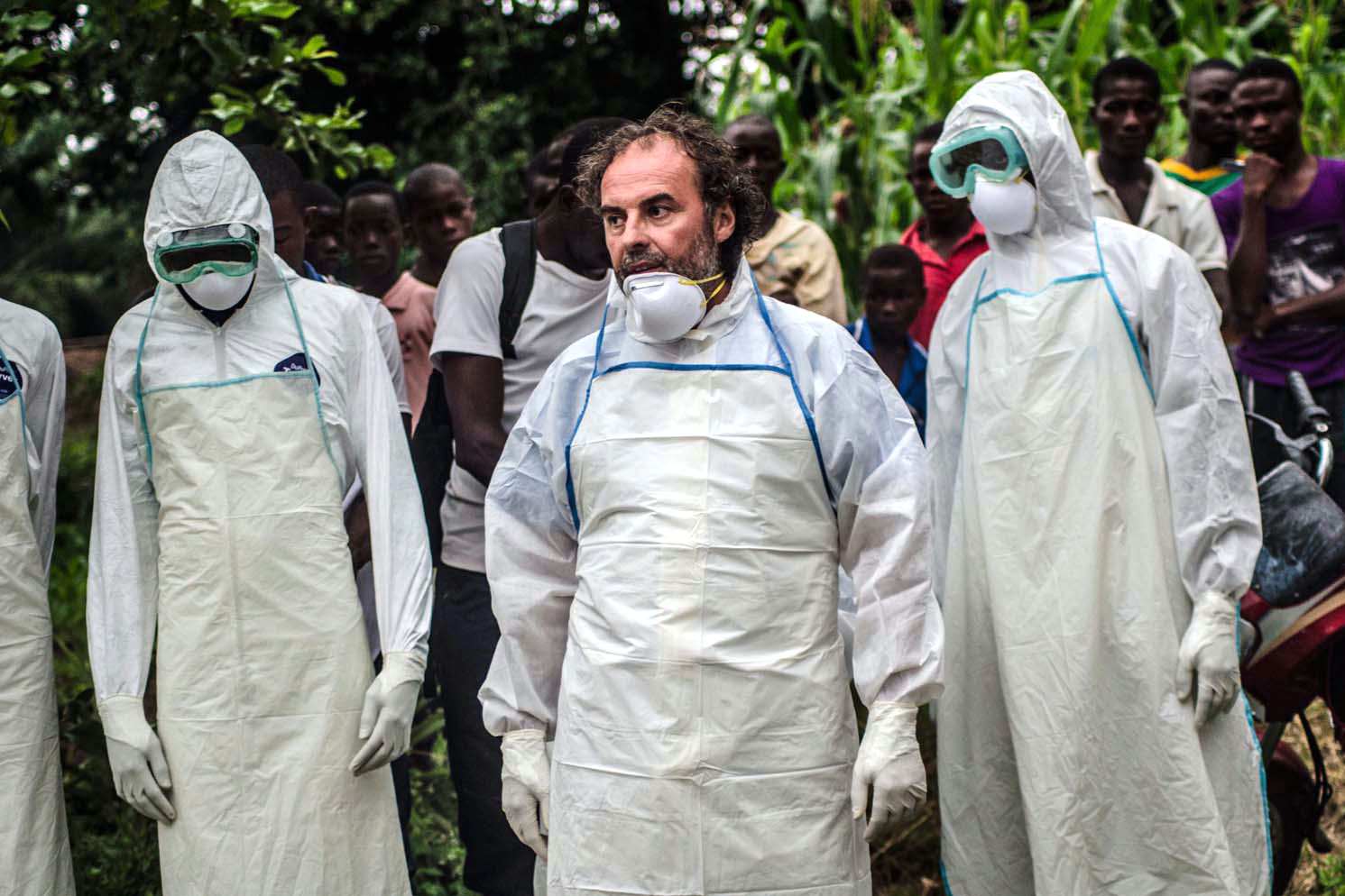Jose Rovira (center), a World Health Organization logistics expert, trains residents of Pendembu to bury an Ebola victim without touching the body -- a dramatic change in a place where family and friends traditionally wash and embrace a loved one's body.
