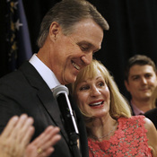 Senate nominee David Perdue hugs his wife Bonnie after declaring victory in the Georgia Republican runoff election Tuesday.