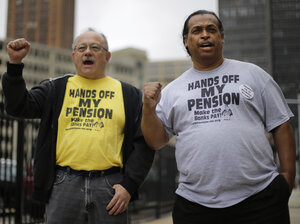 Retirees Mike Shane (left) and William Davis protest near the federal courthouse in Detroit on July 3. Workers and retirees approved pension