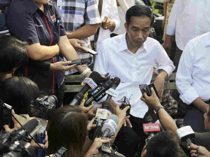 Indonesian presidential candidate Joko Widodo talks to the media during his visit at a reservoir development project in Jakarta on Tuesday.