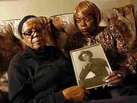 Alma Murdough and her daughter Cheryl Warner hold a photo of Murdough's son Jerome. Jerome Murdough died in February in a Rikers Island jail cell. New York City officials say the cell was at least 100 degrees when his body was discovered.
