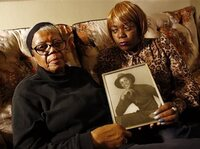 Alma Murdough and her daughter Cheryl Warner hold a photo of Murdough's son Jerome on March 12, at her home in the Queens borough of New York. Jerome Murdough died last month in a Rikers Island jail cell that multiple city officials say was at least 100 degrees when his body was discovered.