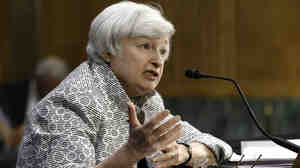 "Federal Reserve Chair Janet Yellen testifies before the Senate Banking Committee on July 15. She said the Fed is likely to keep interest rates low ""for a considerable period"" since inflation remains so tame."